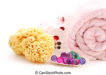 Spa - Pink rolled up towel with bath beads and natural...