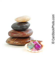 Spa - Stack of balanced stones with bath beads isolated on...