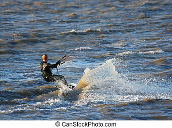 Kiteboarder in the spray - Kiteboarder being pulled through...