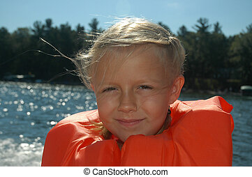 Cute Lifejacket Girl - Grinning young girl in life jacket on...