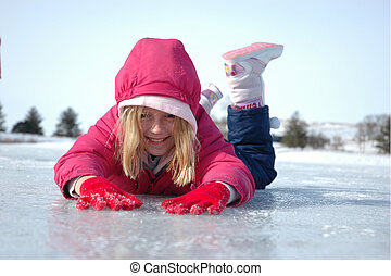 Belly Down on Ice 3 - Young girl prone on the ice during...