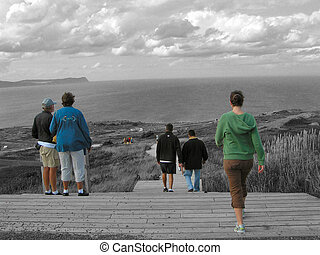 walking tourist 2 - tourists walk down a boardwalk