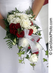 Wedding flowers - Bride holding bouquet of flowers