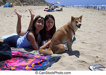 Girls & Dog at Beach - Girls and their Shiba Inu dog relax...