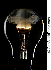 Exploding bulb - Exploding lightbulb on black background