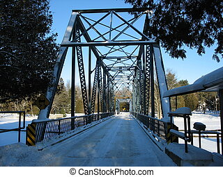 iron swing bridge - century old iron swing bridge over a...