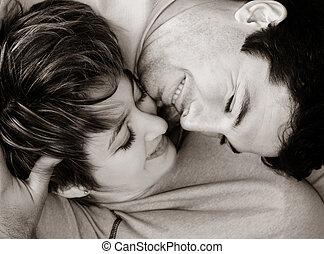 Sweet young couple lying on the rug
