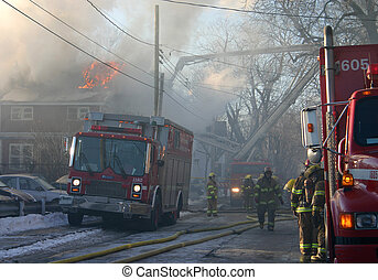 House Fire Smoke - firefighters at the scene of a burning...