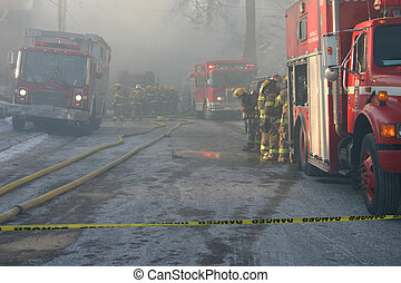 Fire Trucks Danger - firefighters at the scene of a burning...