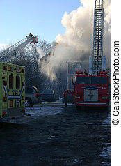 House Fire Smoke - firetruck and ambulance at the scene of a...