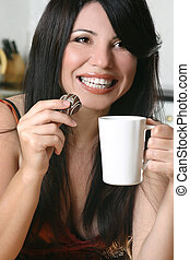 Timeout with coffee and chocolate - A woman enjoys coffee...