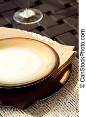 Table setting on a patio table with plates and place mats