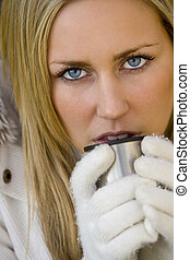 Keeping Warm - A stunningly beautiful blue eyed young woman...