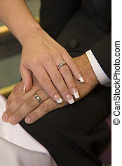 wedding hands - couple holds hand after wedding ceremony is...