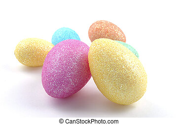 Glittery Easter Eggs - Colorful glittery egg shapes on a...