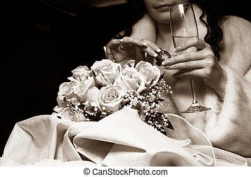 Champaign and candy - Genre scene in sepia: Bride has a bite...