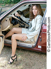 Woman Exiting Car 1 - Sexy, attractive brunette woman...