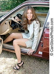 Woman Exiting Car 3 - Sexy, attractive brunette woman...