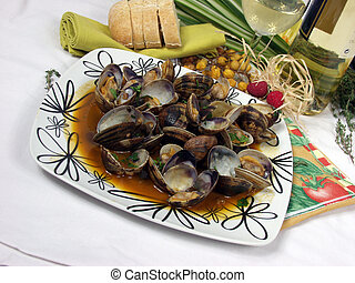 Clams - clams on garlic and paprika sauce with decoration