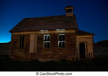 Haunted building - Light from the interior of an abandoned...