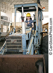 Female Heavy Equipment Operator - A female construction...