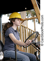 Female Construction - A female construction worker driving...