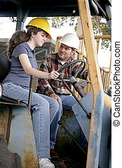 Heavy Equipment Lessons - A construction foreman teaching a...