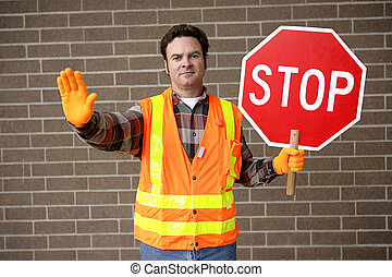 Crossing Guard - A friendly school crossing guard holding a...