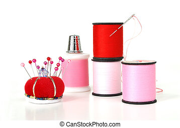 Sewing Notions on White - pink and red thread, a thimble, a...