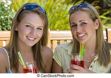 Summertime Friends - Two beautiful young blond women...