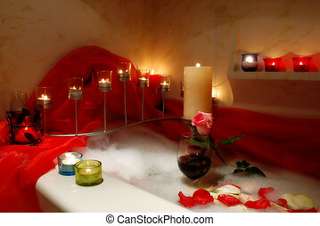 romantic bathroom - bathtube surrounded with candles,...