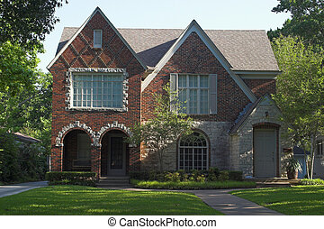 Stone and Brick Duplex - stone and brick duplex with three...