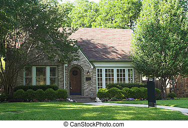 House Sold - house with sold sign in yard; space on sign is...