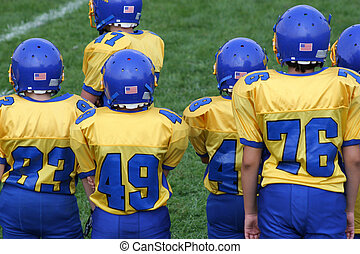 Football Team Boys - Colorful football team on the sidelines...