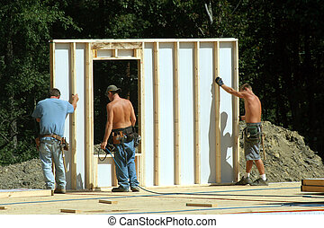 Construction - Building the wall of a modular residential...