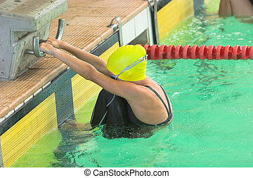 Start girl - Girl on the starting blocks for backstroke swim