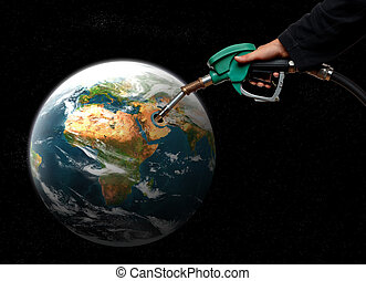 fill - hand filling fuel in planet earth concept