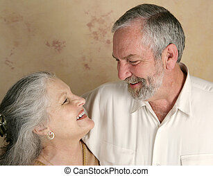 Laughing Couple - A mature couple laughing together. Focus...