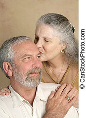 Tender Kisses - A handsome mature man getting a kiss from...