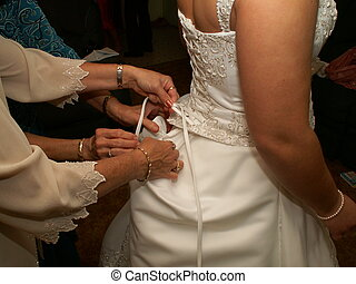 Readying the bride - Mother and grandmother assisting bride