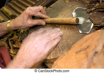 hand made cigars - MOTION BLUR man making holding handmade...