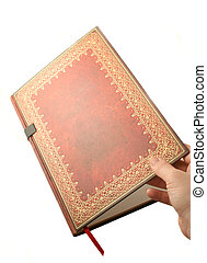 gold paged book - isolated hand opening decorative gold...