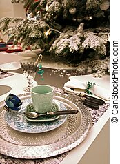 Christmas decoration on table with holiday set