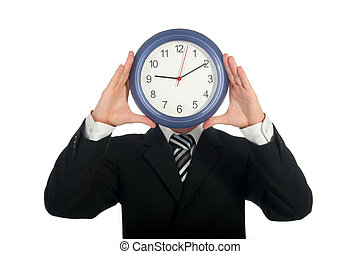 Holding clock - Businessman holding clock in front of his...