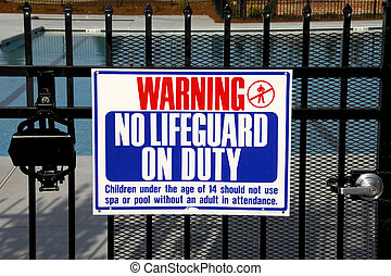 No Lifeguard - warning sign to swimmers that no lifeguard is...