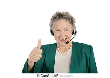 Senior Phone Worker Thumbs Up - A senior phone bank...