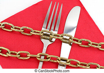 concept of diet - chain and fork with white background,...