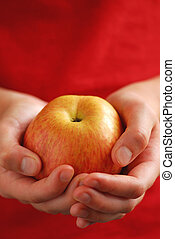 Apple in hands