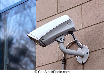 Security camera - Security video camera on outside wall of a...