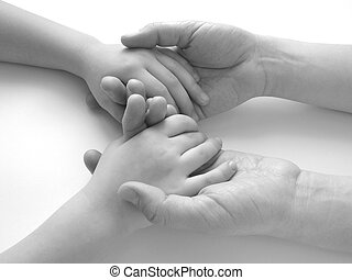 hand in hand - close-up of the child\\\'s hands in...